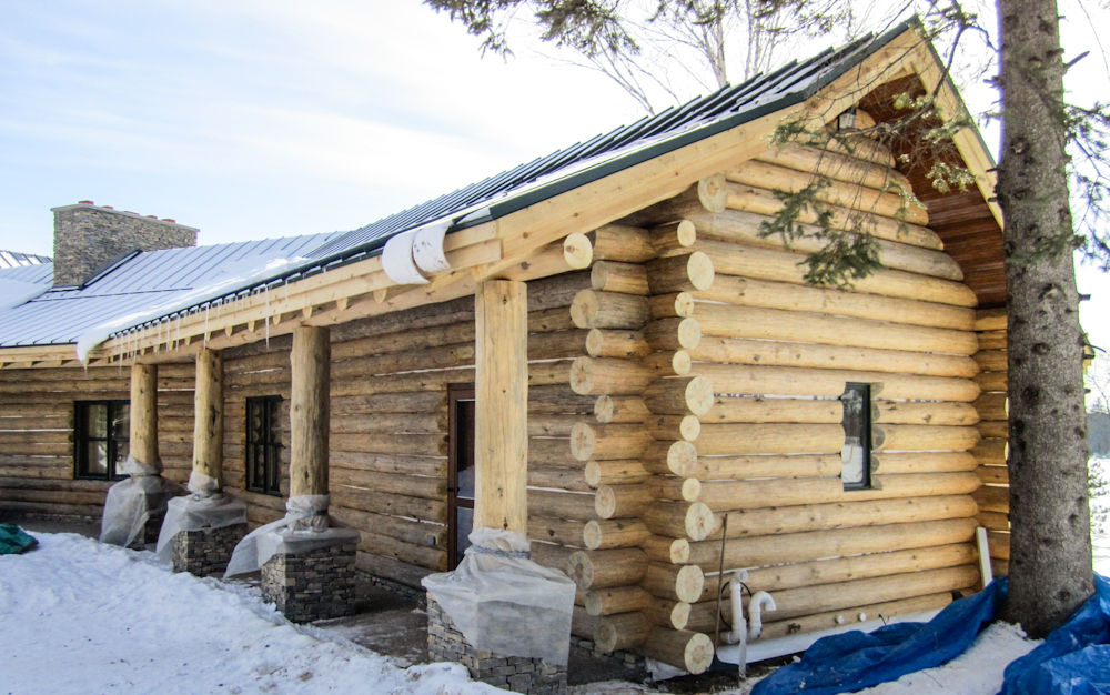 times story featured benefits cedar log siding walls image leland of versus lelands stacked cabin the cabins vs full